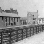 Haxey Station viewed from the south with the station master's house in the background and the road gates closed taken about 1910