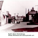 Newbigg, Booth's Motor Works and Carpenters Arms with motorcycle/ milk cart in the road about 1920