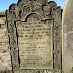 A heavily worked, ornate and presumably expensive headstone for a man who seemed have been in a manual trade, ie a bricklayer